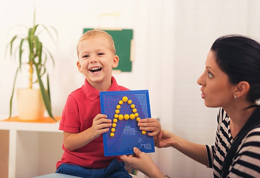 child in speech therapy session
