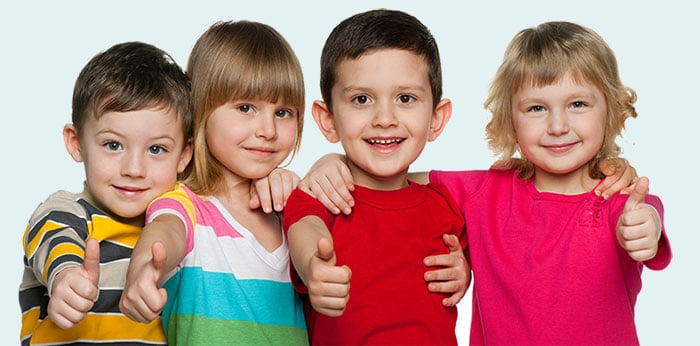 four children with thumbs up